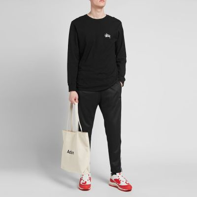 NIKE TAPED POLY TRACK PANT