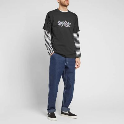 RAISED BY WOLVES CAR WASH TEE